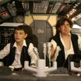Han Solo and young Solo aboard the Falcon